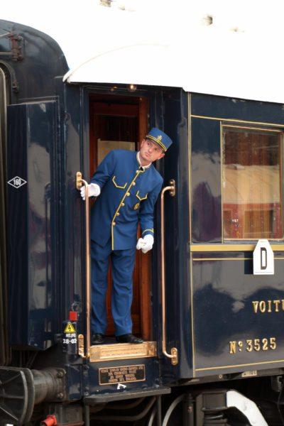 Orient express staff in doorway